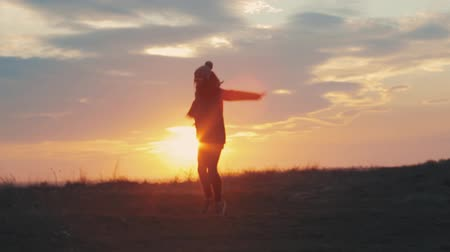 jump : Happy girl jumping at sunset Stock Footage