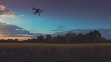 drone : Custom drone hexacopter flying in the sky at sunset