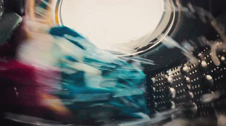 çamaşırhane : Laundry is spinning in the washing machine (inside view) Stok Video