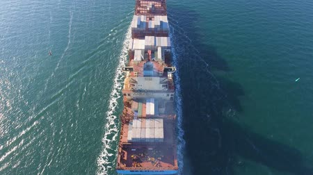 навигацион судно : Aerial view of container ship passes through the channel goes into the open ocean after loading in the port of China at full speed. 4K.