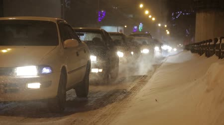 greenpeace : Traffic jam in the city during a rush hour in the winter Stock Footage