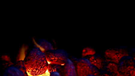 grelha : closeup of glowing coal with some flames