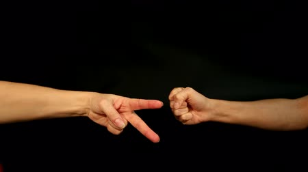 be sad : two female hands are playing rock, paper, scissors