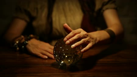 servet : female fortune teller looks in the future and lifts thumb up