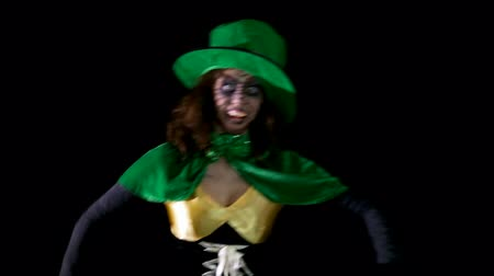 pagan feast : female leprechaun is dancing through the room
