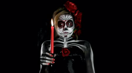 folga : bored female sugar skull with candle, walking through the room Stock Footage