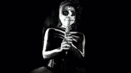 catrina : dancing female sugar skull with candle, black and white