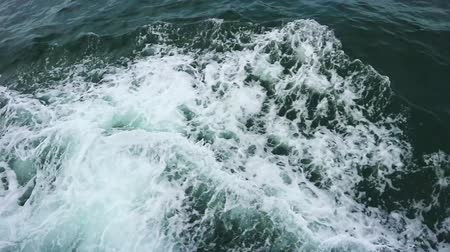 top of waving blue ocean sea water with splashing foam from marine transport boat motion footage. Wideo