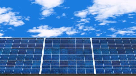 blue solar panels cell with blue cloud sky times lapse background in electricity generating farm motion footage.
