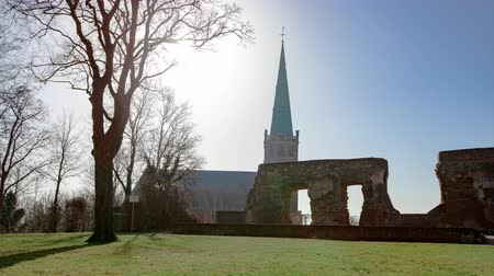 templomtorony : Timelapse of the European Church Chapel Heinsberg Landmark with City Walls Ruins And Green Meadow with a Dead Tree Stock mozgókép