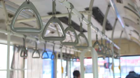 inside bus : Handrail on the moving bus without people and empty space mass transit systems