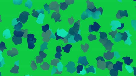 proměna : Moving abstract background. Transforming polka dot pattern on green screen background. Looping footage.