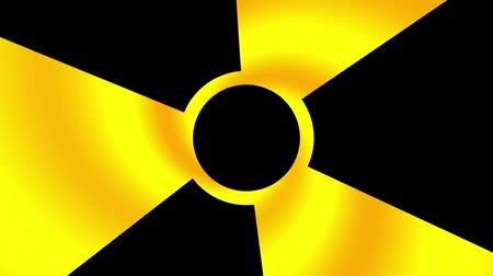 radioaktivní : Spinning a radiation warning symbol. Looping footage.