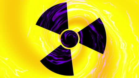 cuidado : Spinning a radiation warning symbol. Looping footage.