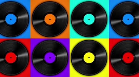 lemezek : Spinning vinyl discs on simple colors background. Seamless looping footage.