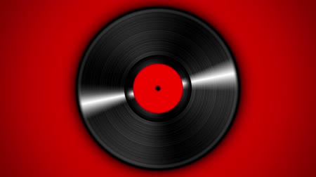 dyskoteka : Spinning vinyl discs on simple red background. Seamless looping footage.