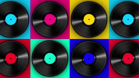 dyskoteka : Spinning vinyl discs on simple colors background. Seamless looping footage.
