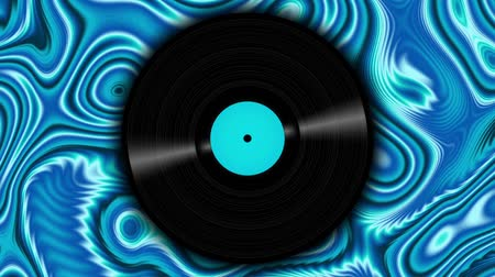 lemezek : Spinning vinyl discs on abstract moving background. Seamless looping footage. Stock mozgókép