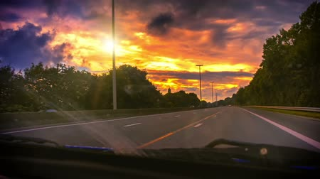 POV footage of driving on highway at spectacular summer sunset. Full HD, 1080p