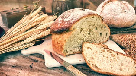 Freshly baked bread in rustic setting. Slider shot. 4k, Ultra High Definition, Ultra HD, UHD, 2160P, 3840 x 2160