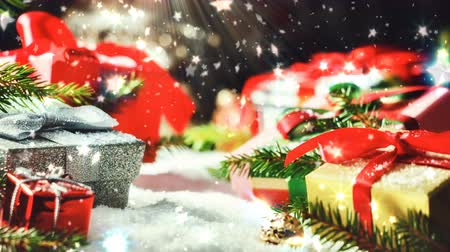 Christmas holiday setting with presents in various boxes laying in snow. Christmas background, slider (dolly) shot, zoom in, 4k Stock Footage