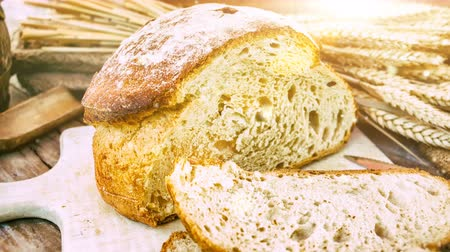 Freshly baked bread in rustic setting. Slider shot. 4k, Ultra High Definition Stock Footage