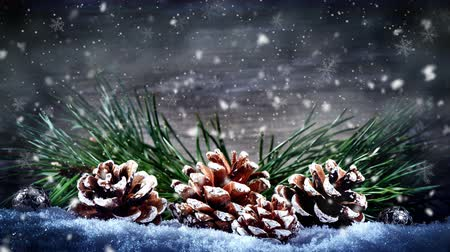 Christmas seamless looping with falling snow. Christmas background with pine cones and fir tree branches. 4k Stock Footage