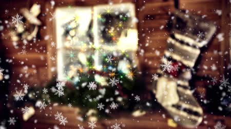 Magic Christmas background with illuminated frosty window and seamless looping of falling snowflakes. 4k Stock Footage