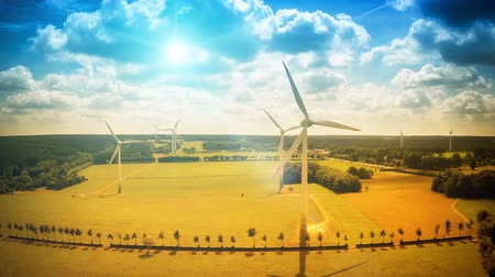 Aerial view of summer countryside with wind turbines and agricultural fields. Nature background. Full HD, 1080p