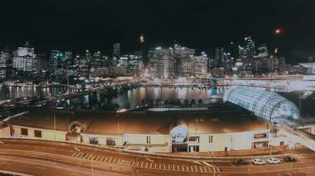 darling : Night Cityscape Time Lapse Of Darling Harbour Skyline Sydney, NSW, Australia. Showing Busy Nightlife Traffic Including CBD, Bridge, Boats And People Walking Around Marina And Jetties