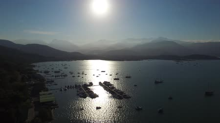 backgroundpictures : Beautiful sunset aerial view with boats at Paraty, Rio de Janeiro, Brazil.