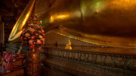 wat pho : BANGKOK - MARCH 16. Reclining Buddha in Wat Pho temple on March 16, 2012 in Bangkok, Thailand. Wat Pho is named after a monastery in India where Buddha is believed to have lived.