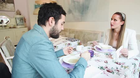 двадцатые годы : Young couple eating soup in a restaurant