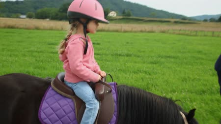 poník : Little girl riding a pony in countryside Dostupné videozáznamy