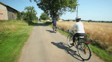 emekli : Retired couple cycling on road in village in France