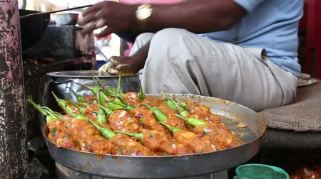 indie : Close view of food preparationon street stall in India.