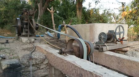 improvised : Large motorized machine working in rural backyard in Jodhpur, side view. Stock Footage
