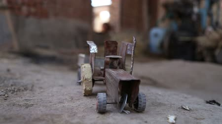 improvised : Truck toy on ground in house in Jodhpur, closeup.