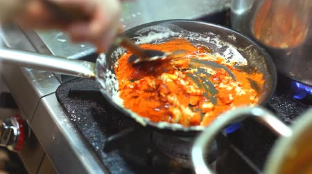 chili : Chef preparing sauce in frying pan