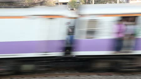 holiday makers : Two trains passing each other during departure in Mumbai. Stock Footage