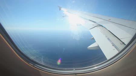view of airplane wing through plane window