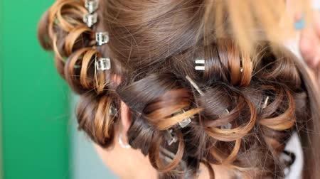 curling hair : Hair stylist curling hair of future married woman Stock Footage