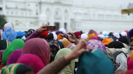 sharpened : Group of people at street in Amritsar, back side view of covered heads.