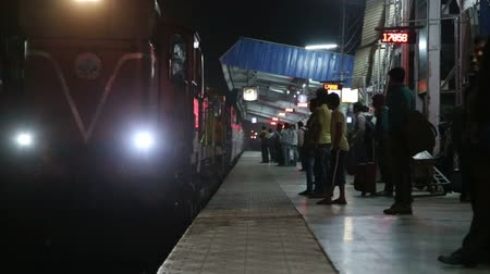 train station : MUMBAI, INDIA - 12 JANUARY 2015: Train arriving at the train station in the night time in Mumbai.