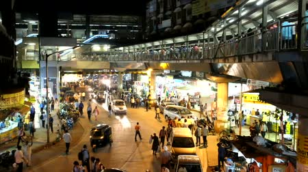 holiday makers : People and vehicles at train terminal in night time.