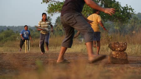 kriket : GOA, INDIA - 25 JANUARY 2015: Indian boys playing cricket at the playing field in Goa. Stok Video