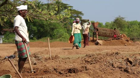 černoch : GOA, INDIA - 26 JANUARY 2015: Man and woman standing to take rest at the working site.