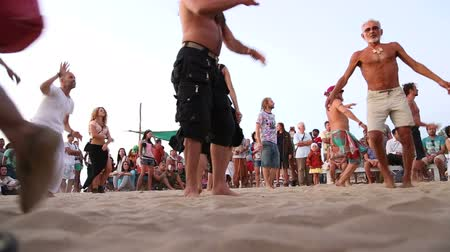 goa beach : GOA, INDIA - 19 JANUARY 2015: People dancing on a sandy beach to the music played by djembe band.