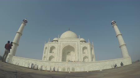 points of interest : Front facade of Taj Mahal with people passing, time lapse. Stock Footage