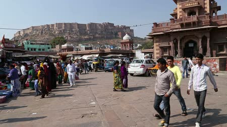 bazar : JODHPUR, INDIA - 11 FEBRUARY 2015: People and vehicles passing down the street beneath Mehrangarh fort.